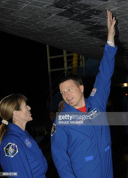 Space shuttle Endeavour STS130 Pilot Terry Virts speaks with Mission Specialist Kathryn Hire as post flight inspections are conducted after the crews...