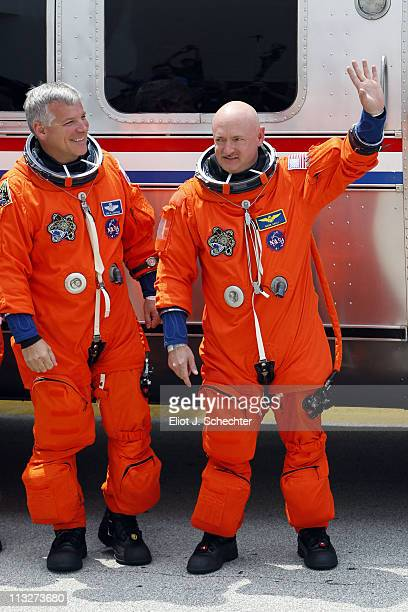 Space Shuttle Endeavour STS-134 Commander Mark Kelly and Pilot Greg H. Johnson walk out of the Operations and Checkout Building at the Kennedy Space...