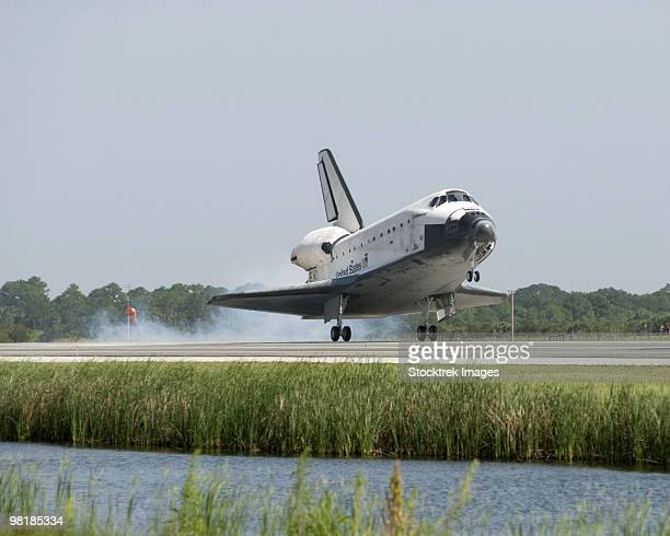 Space Shuttle Endeavour touches down on the runway at Kennedy Space Center.