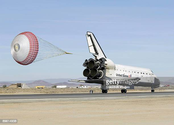 Space Shuttle Endeavour with its drag chute deployed.