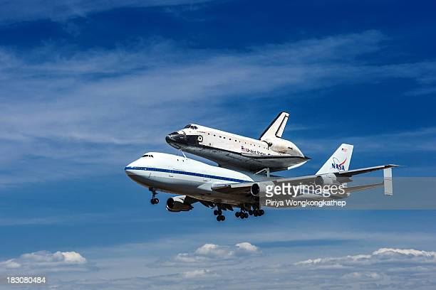CONTENT] Space Shuttle Endevour located on top of NASA jet carrier was about to land at LAX after the historic flyover around California