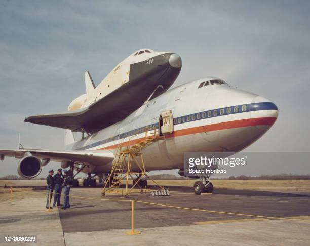 Space Shuttle Enterprise arrives atop NASA 905, a 747 carrier aircraft in the background, at Redstone Arsenal Airfield near Huntsville, Alabama, 13th...