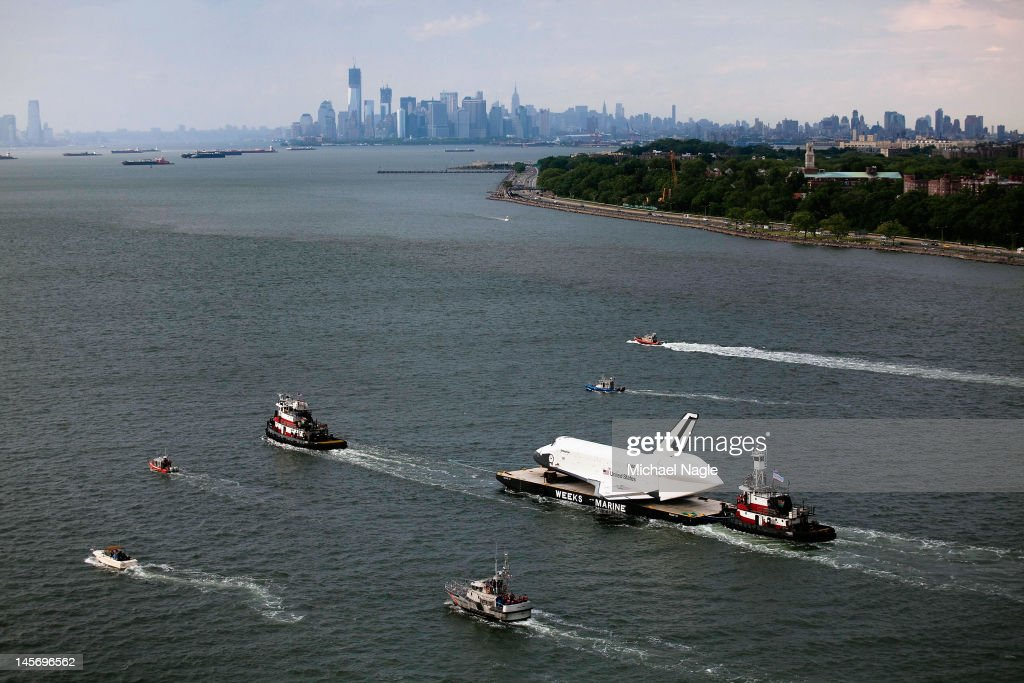 Space Shuttle Enterprise is carried by barge into New York Harbor on June 03, 2012 in New York City. Enterprise is on it's way to the Intrepid Sea, Air and Space Museum, where it will put on permanent display.