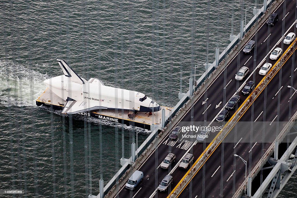Space Shuttle Enterprise is carried by barge underneath the Verrazano-Narrows Bridge on June 03, 2012 in New York City. Enterprise is on it's way to the Intrepid Sea, Air and Space Museum, where it will put on permanent display.
