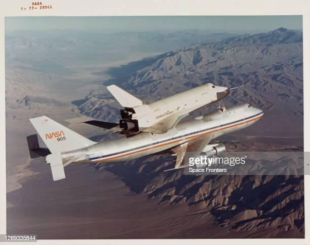 Space Shuttle Enterprise rides piggyback atop NASA 905, a 747 carrier aircraft, at the start of its first 'tail cone off' unpowered flight over the...