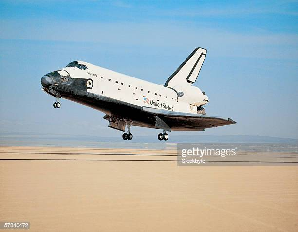 space shuttle landing - space shuttle stock photos and pictures