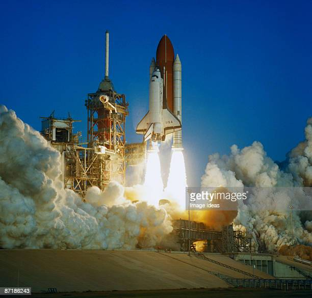 space shuttle lifting off launch pad - space shuttle stock photos and pictures