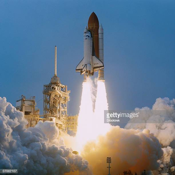 space shuttle liftoff - spaceship stock photos and pictures