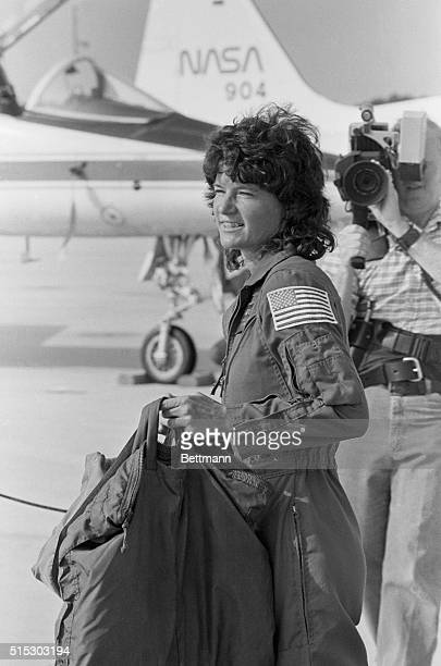 Space shuttle mission specialist Sally Ride the first American woman sent into space totes her luggage following her arrival at the Kennedy Space...