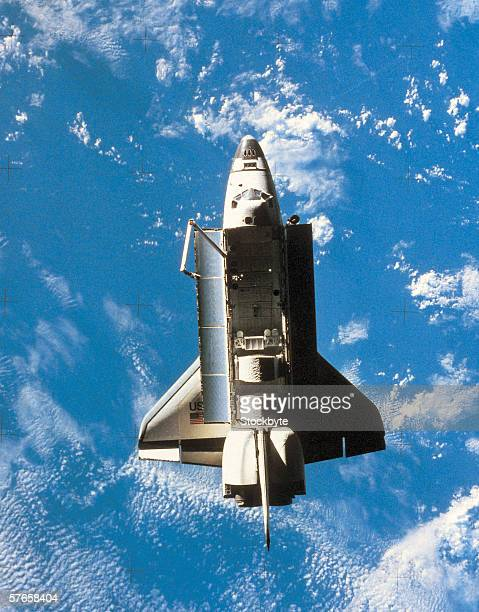 Space shuttle orbiting above earth