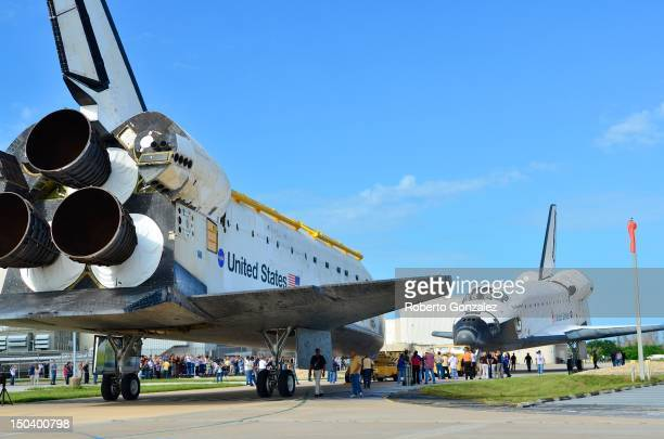 Space Shuttles Atlantis and Endeavour face each other as they as Endeavour backs out of the Orbiter Processing Facility and Atlantis is moved out of...