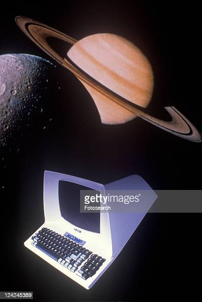 Space special effects composite of computer, moon and Saturn