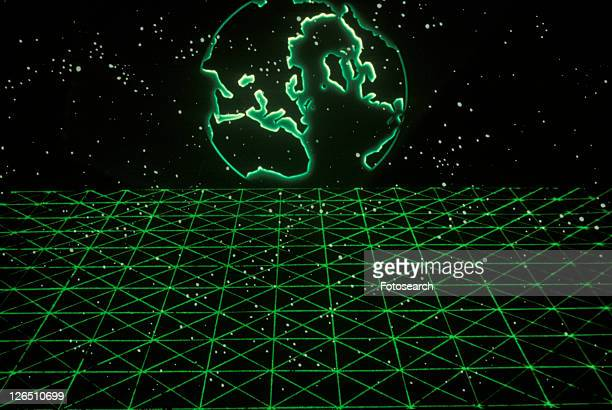 Space special effects composite with Earth silhouette and grid of green laser light