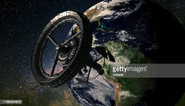 space station orbiting earth over the americas - space station stock pictures, royalty-free photos & images