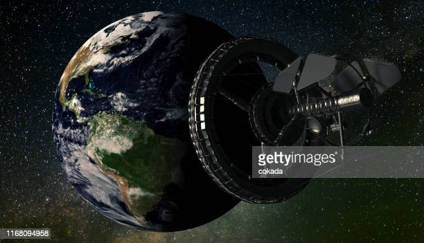 space station orbiting earth - international space station stock pictures, royalty-free photos & images
