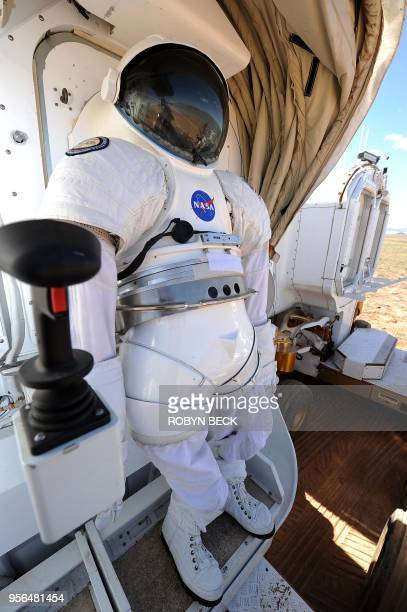 A space suit is mounted to a suit port on the outside of NASA's newest rover prototype Space Exploration Vehicle 15 September 2010 on the last day of...