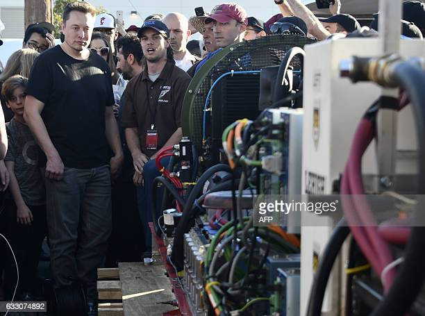 Space X CEO Elon Musk looks over a pod constructed by Ales Tech from Pisa Italy during testing for the SpaceX Hyperloop competition in Hawthorne...
