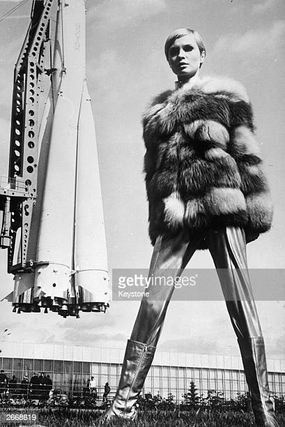 Spaceage styling from Russian designers as Moscovite model Galina Milovskaya wears a metallic ensemble with a red fox fur jacket leggings and silver...