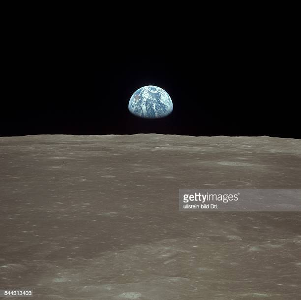 Spaceflight United States of America Moon landing of Apollo 11 in 1969 View from lunar module 'Eagle' earthrise sequence earth rises over lunar...
