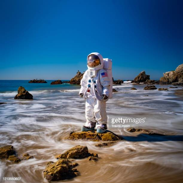 spaceman in the surf - astronaut stock pictures, royalty-free photos & images