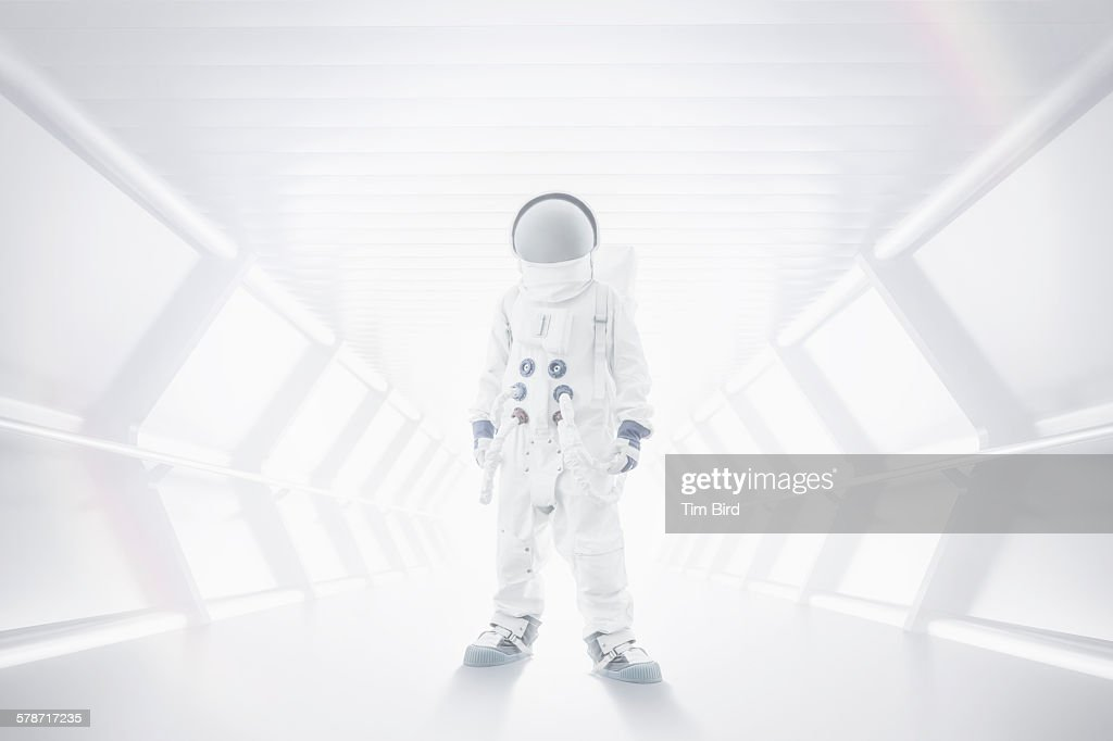 Spaceman standing in tunnel : Stock Photo