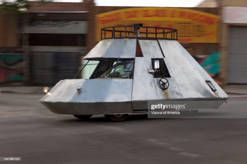 Spaceship automobile driving the streets of Queens and Bushwick, New York : News Photo