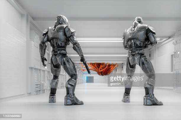 spaceship futuristic cyborg soldiers against alien intruder - war stock pictures, royalty-free photos & images