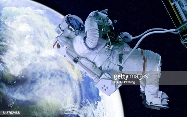 Spacesuit A pressurized watertight suit that provides the astronaut with oxygen and protects against solar rays and meteorites during space walks
