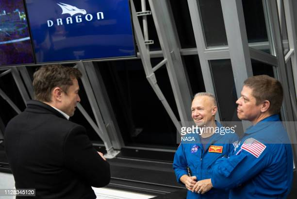 SpaceX CEO and Chief Designer Elon Musk, left, speaks with NASA astronauts Doug Hurley, center, and Bob Behnken, right, who are assigned to fly on...