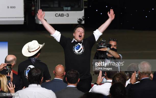 SpaceX CEO Elon Musk celebrates the successful launch of a Falcon 9 rocket with the Crew Dragon spacecraft from pad 39A at the Kennedy Space Center...