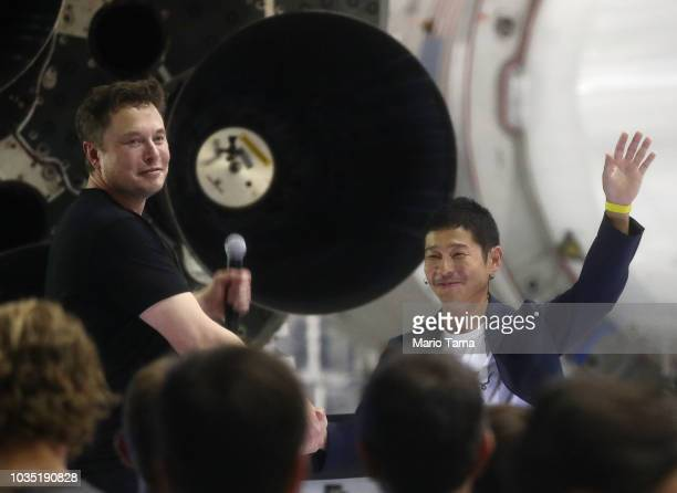 SpaceX CEO Elon Musk shakes hands with Yusaka Maezawa the Japanese billionaire chosen by the company to fly around the moon on September 17 2018 in...
