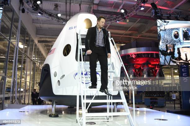 SpaceX CEO Elon Musk unveils SpaceX's new sevenseat Dragon V2 spacecraft in Hawthorne California on May 29 2014 The private spaceflight companys new...