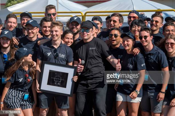 SpaceX chief Elon Musk poses with students from the the Technical University of Munich after their pod won the 2019 SpaceX Hyperloop Pod competition...