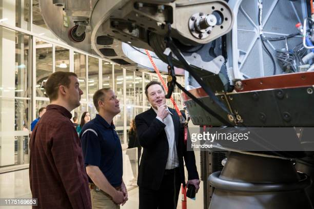 SpaceX Chief Engineer Elon Musk speaks with NASA Administrator Jim Bridenstine while viewing the OctaWeb, part of the Merlin engine used for the...