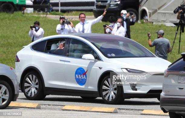 SpaceX Crew Dragon astronauts Doug Hurley and Bob Behnken wave to supporters as they are driven to the launch complex at Kennedy Space Center Fla...