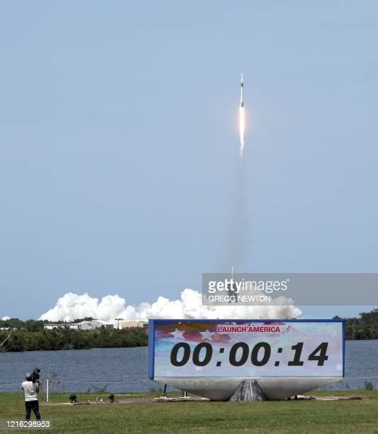 A SpaceX Falcon 9 rocket carrying the Crew Dragon spacecraft lifts off from launch complex 39A at the Kennedy Space Center in Florida on May 30 2020...