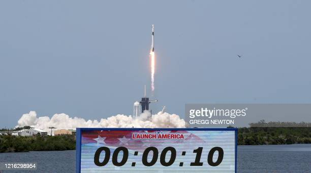 SpaceX Falcon 9 rocket carrying the Crew Dragon spacecraft lifts off from launch complex 39A at the Kennedy Space Center in Florida on May 30 2020...