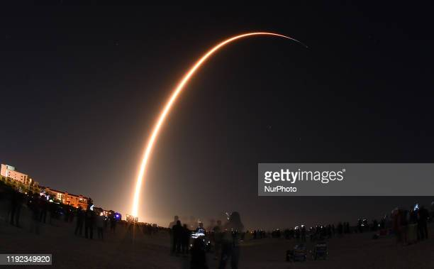 SpaceX Falcon 9 rocket is seen in this time exposure from Cocoa Beach, Florida as it launches the company's third Starlink mission on January 6, 2020...