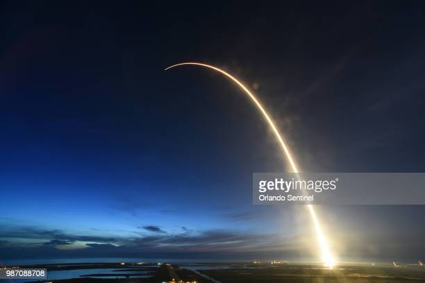 A SpaceX Falcon 9 rocket launched just before dawn Friday June 29 2018 is captured during a time exposure at Launch Complex 40 at Cape Canaveral Air...
