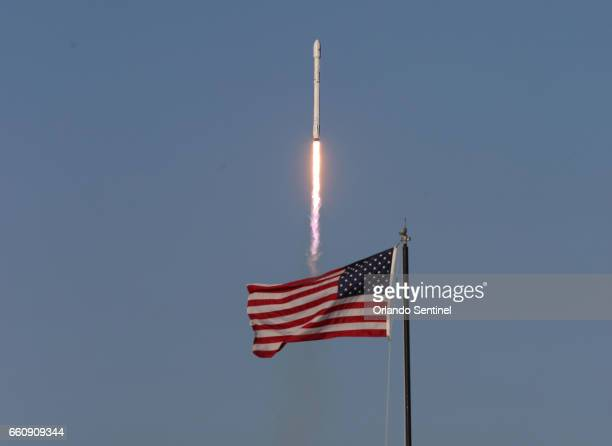 A SpaceX Falcon 9 rocket powered by a previously flown firststage rocket blasts off from launch pad 39A on Thursday March 30 carrying a SES 10...