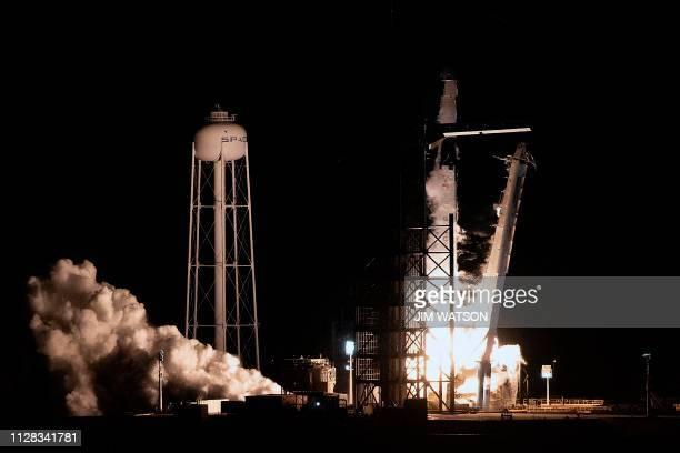 SpaceX Falcon 9 rocket with the company's Crew Dragon spacecraft onboard takes off during the Demo1 mission at the Kennedy Space Center in Florida on...
