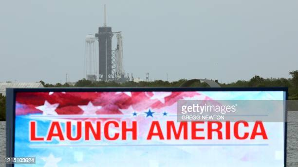 A SpaceX Falcon 9 rocket with the Crew Dragon spacecraft sits atop launch complex 39A at the Kennedy Space Center in Florida on May 25 2020 NASA...