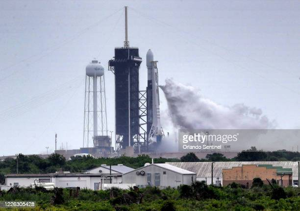 SpaceX Falcon 9 vents during fueling about 15 minutes before the launch was scrubbed due to lightning in the area of Launch Complex 39-A at Kennedy...