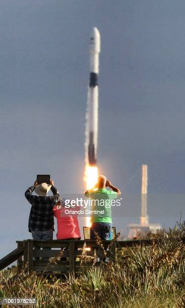 SpaceX fans watch the Falcon 9 liftoff from pad 39A in this view from Playalinda Beach Fla just north of the Kennedy Space Center Thursday Nov 15 2018