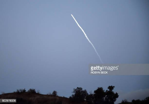 SpaceX flies in the distance over Los Angeles after it made its fourth attempt at launching a Falcon 9 satellitecarrying rocket from Vandenberg Air...