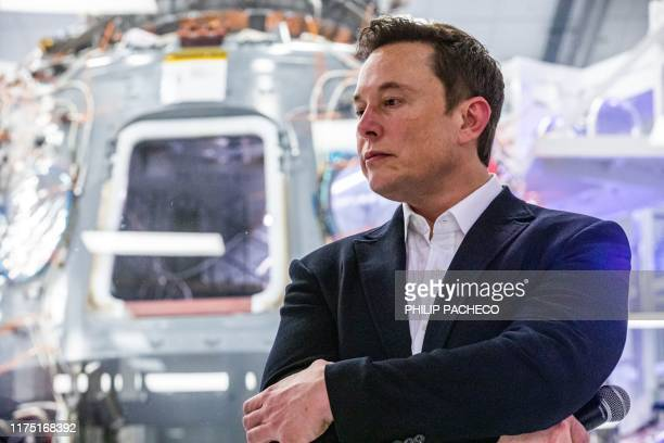 SpaceX founder Elon Musk addresses members of the media during a press conference announcing new developments of the Crew Dragon reusable spacecraft,...