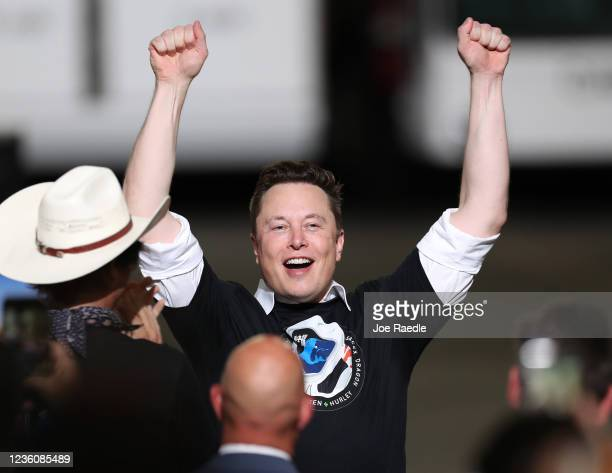 Spacex founder Elon Musk celebrates after the successful launch of the SpaceX Falcon 9 rocket with the manned Crew Dragon spacecraft at the Kennedy...