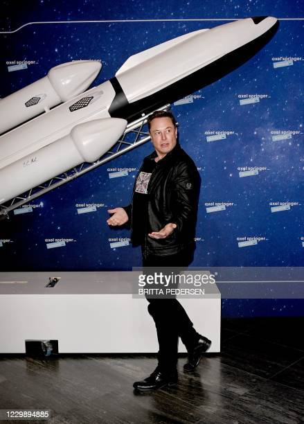 SpaceX owner and Tesla CEO Elon Musk gestures as he arrives on the red carpet for the Axel Springer Awards ceremony, in Berlin, on December 1, 2020.