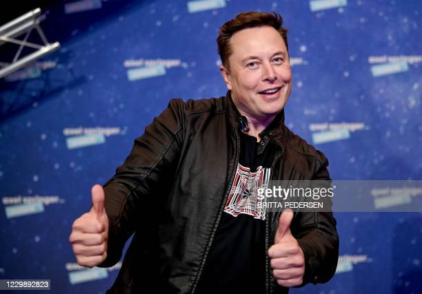 SpaceX owner and Tesla CEO Elon Musk poses as he arrives on the red carpet for the Axel Springer Awards ceremony, in Berlin, on December 1, 2020.