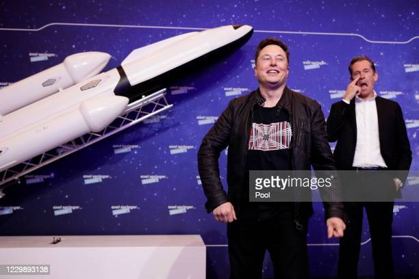 SpaceX owner and Tesla CEO Elon Musk poses next to Axel Springer's Chairman of the Board Mathias Doepfner on the red carpet of the Axel Springer...